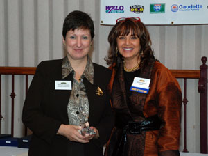 Michelle Fontaine of LaMich Productions and FB Smarty poses with Jeannie Hebert, President of the Blackstone Valley Chamber of Commerce at annual meeting November 2011